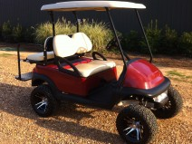 Deep Red Golf cart with custom wheels Mississippi