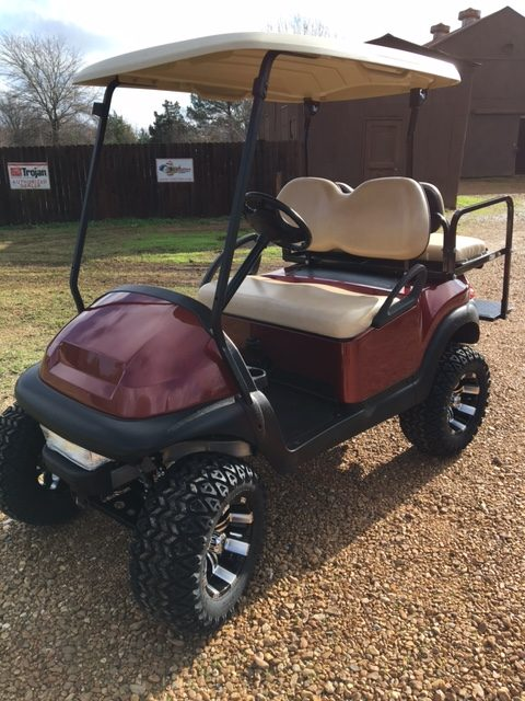 Burgundy lifted golf cart Club car with headlight & flip seat
