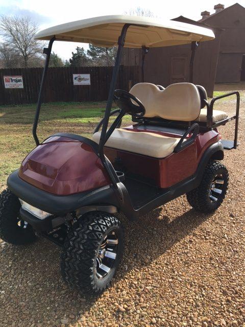 Burgundy lifted golf cart Club car with headlight & flip seat