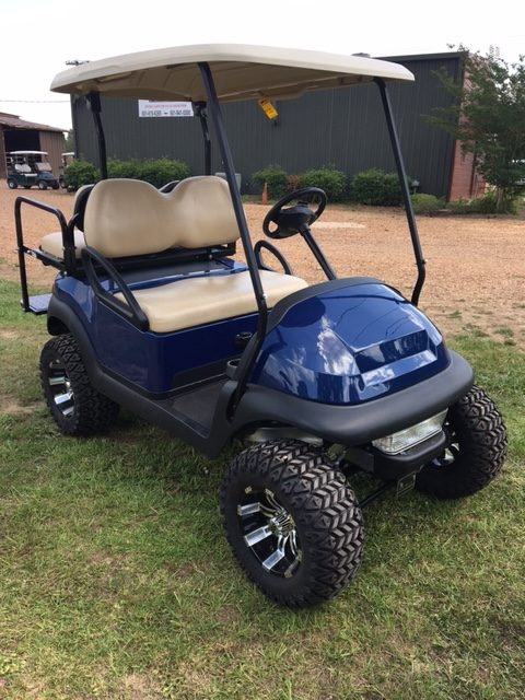 Blue golf cart with big wheels & tires